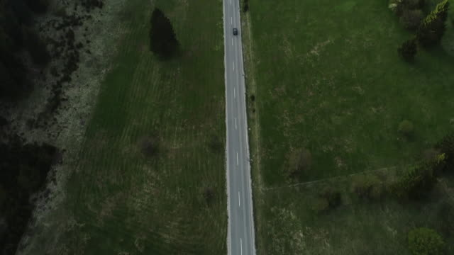 aerial view on car traveling on a road thru beautiful valley - 20 seconds or greater stock videos & royalty-free footage