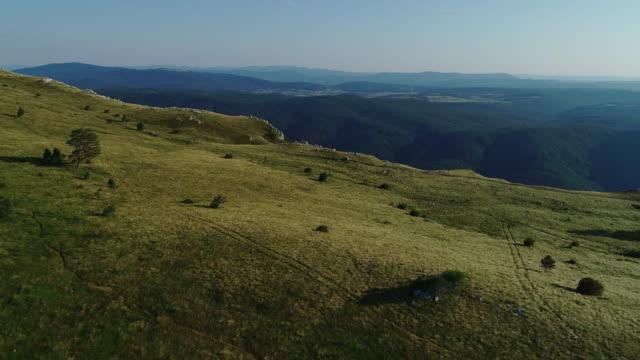 aerial view on edge of a nanos plateau - slovenia stock videos & royalty-free footage