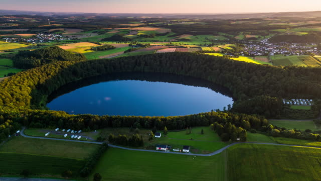 Aerial view on idyllic landscape with circular crater lake - Eifel Germany