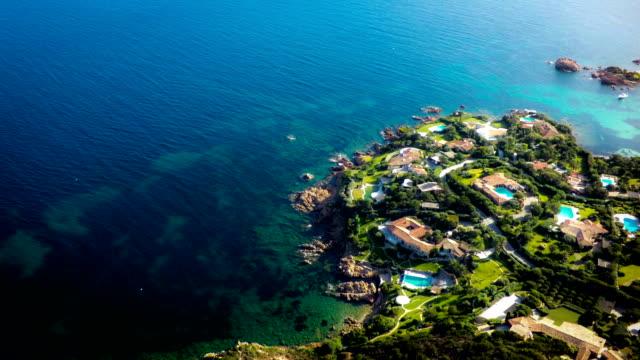 aerial view on luxury houses - sardinia - sardinia stock videos & royalty-free footage