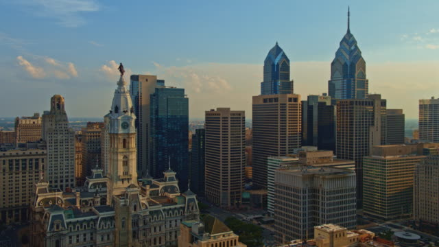 aerial view on philadelphia city hall in front of downtown district, philadelphia, pennsylvania. drone video with the cinematic panoramic-orbiting camera motion. - william penn stock videos & royalty-free footage