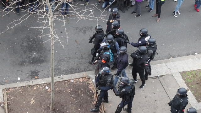 aerial view on police during a day of protest and ongoing transport worker strikes over french pension reform plans on january 11, 2020 in paris,... - reform stock-videos und b-roll-filmmaterial