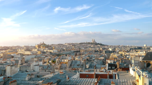aerial view on sacre coeur in paris in 4k slow motion - horizon over land stock videos & royalty-free footage