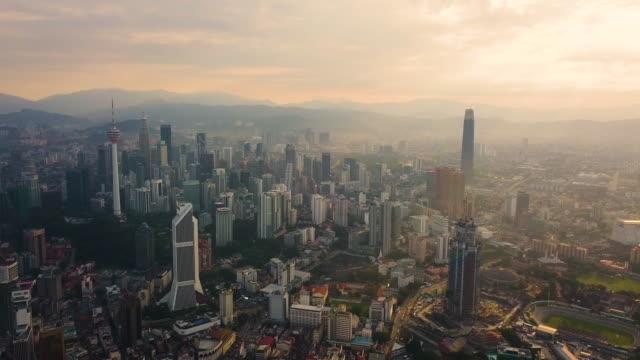 aerial view on sunrise urban city, kuala lumpur, malaysia - kuala lumpur stock videos & royalty-free footage