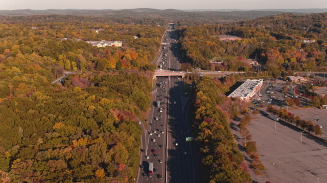 aerial view on the busy highway in mountains in new jersey, usa.  a big plaza is closed, and the parking lot is empty because of the covid-19 pandemic. aerial drone video with the rock-solid camera. - courtyard stock videos & royalty-free footage