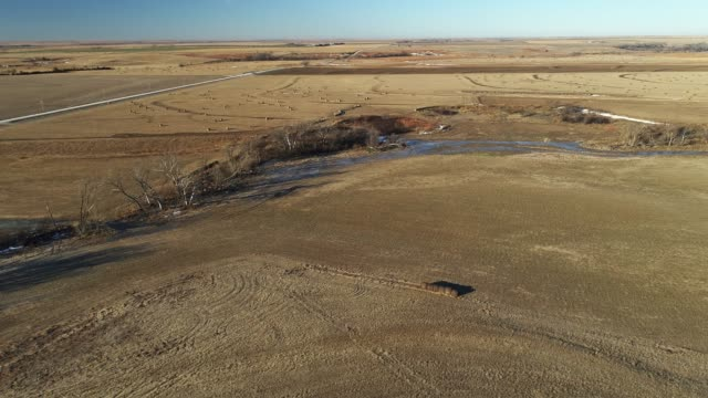 aerial view on the field in kansas in winter. - hay texture stock videos & royalty-free footage