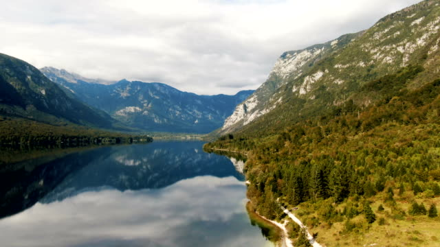 aerial view on the lake of bohinj with it's beautiful surrounding. slovenia - slovenia stock videos & royalty-free footage