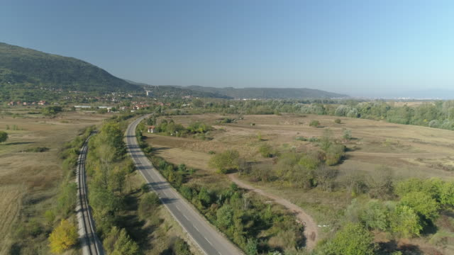 aerial view on the old railway and the road and cityscape - serbia stock videos & royalty-free footage