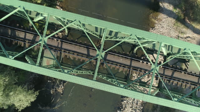 aerial view on the old railway bridge and the road - railway bridge stock videos & royalty-free footage