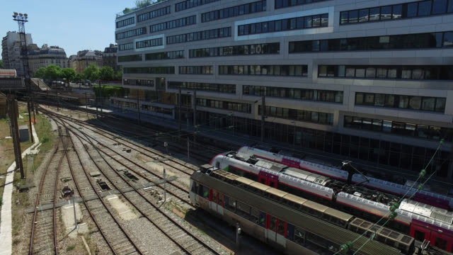 aerial view on the railway tracks, with trains, batignolles district, 75017 paris. france has started a progressive relaxation of its foreclosure... - île de france stock-videos und b-roll-filmmaterial