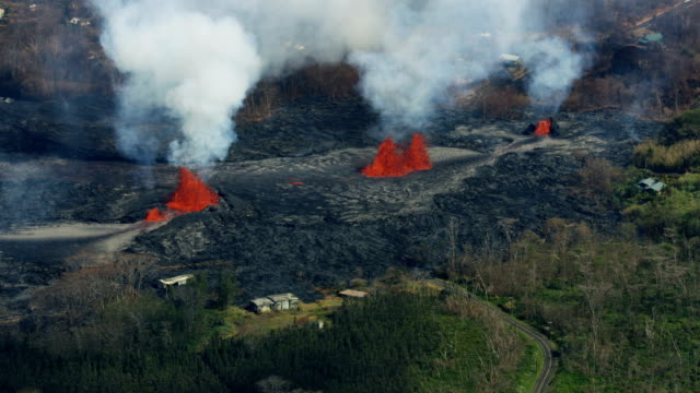 aerial view open fissures volcanic activity destroying landscape - destruction stock videos & royalty-free footage