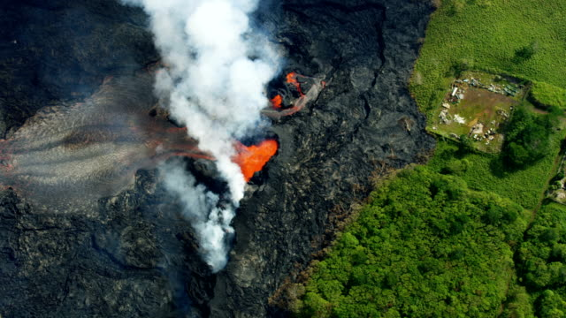 aerial view open fissures volcanic activity destroying landscape - big island hawaii islands stock videos & royalty-free footage