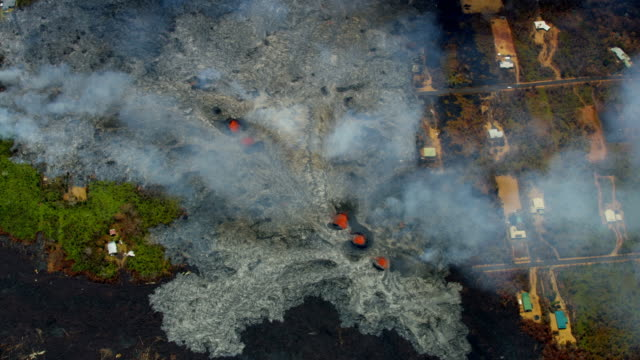 aerial view open fissures volcanic lava destroying landscape - pazifikinseln stock-videos und b-roll-filmmaterial