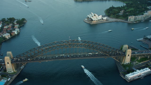 vídeos de stock, filmes e b-roll de aerial view opera house and sydney harbour bridge - sydney australia