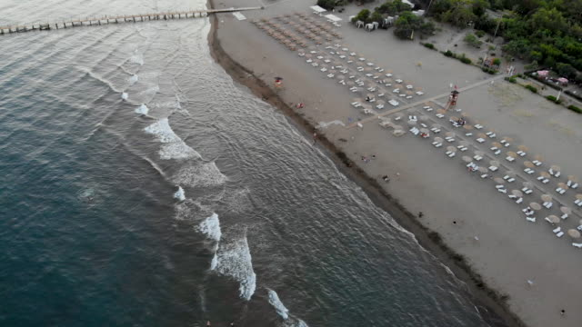 aerial view over a beach in the south of turkey - ozgurdonmaz stock videos and b-roll footage