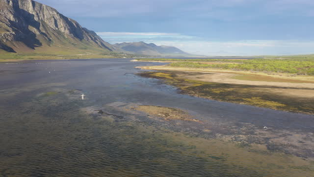 aerial view over a beautiful river estuary and wetland - hermanus stock videos & royalty-free footage