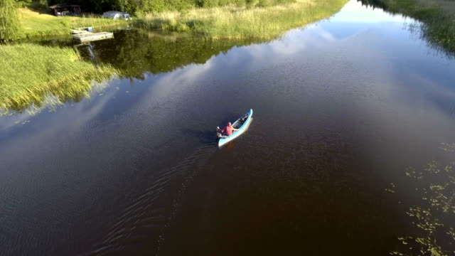 aerial view over a canoe in the swedish archipelago. - wide stock videos and b-roll footage