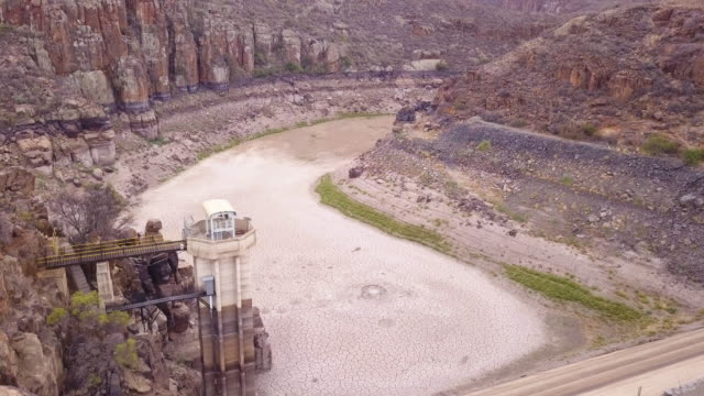 aerial view over a dried up dam - dry stock videos and b-roll footage