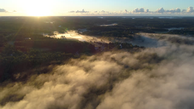 flygfoto över en dimmig landsbygdszon - remus kotsell bildbanksvideor och videomaterial från bakom kulisserna