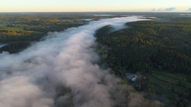 aerial view over a foggy rural zone - stockholm stock videos & royalty-free footage