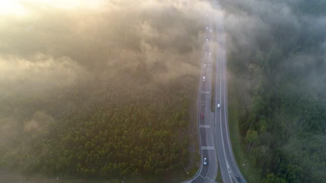 flygfoto över en motorväg i ett lantligt landskap - remus kotsell bildbanksvideor och videomaterial från bakom kulisserna