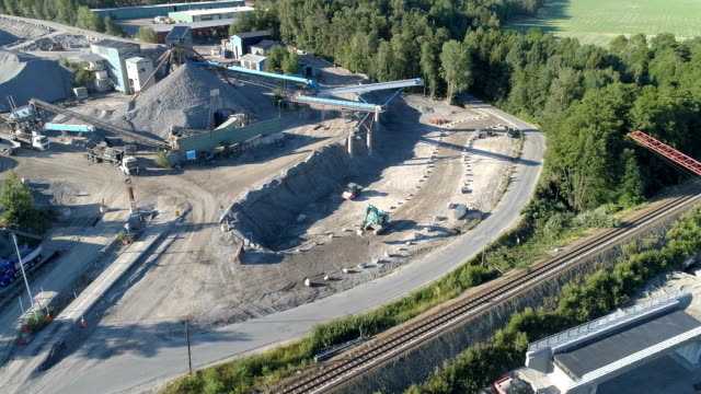 aerial view over a quarry for gravel and sand - gravel stock videos & royalty-free footage