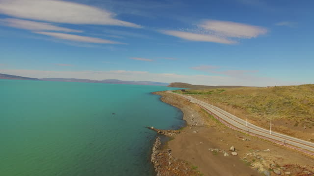 Aerial view over a road next lake at Patagonia.