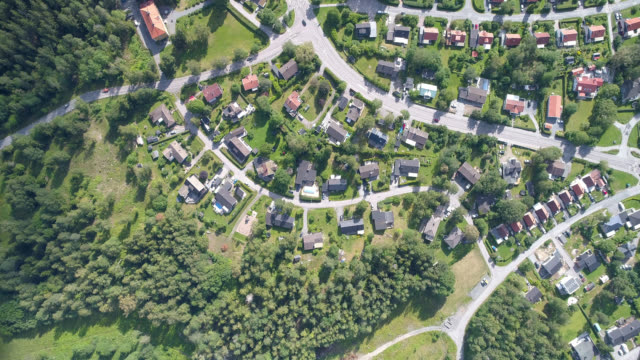 aerial view over a rural city - landing touching down stock videos & royalty-free footage