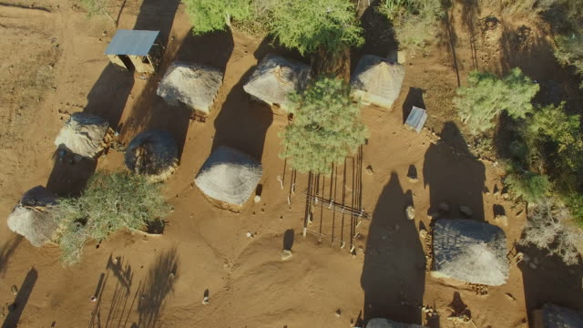 aerial view over a small african village - village stock videos & royalty-free footage