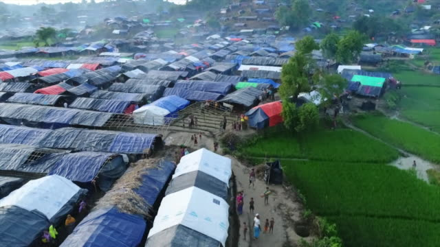 aerial view over a sprawling rohingya refugee camp in teknaf bangladesh - refugee camp stock videos & royalty-free footage