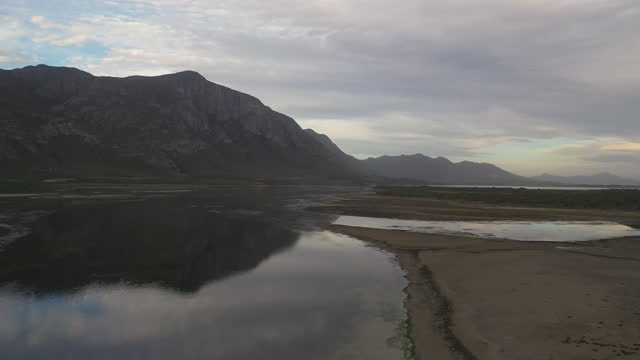 aerial view over a wetland in the late afternoon - hermanus stock videos & royalty-free footage