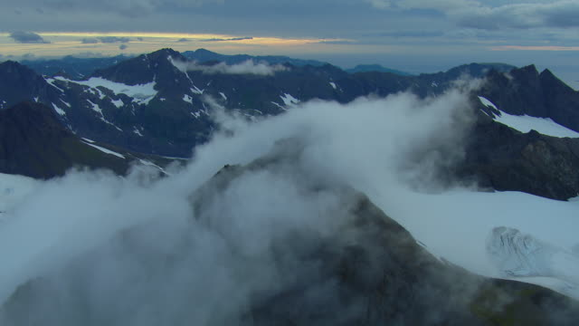 aerial view over alaskan mountain range - homer alaska stock videos & royalty-free footage