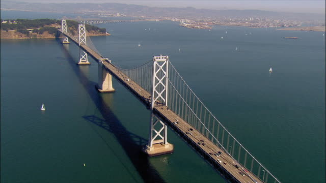 aerial view over bay bridge towards yerba buena island / san francisco, california - san francisco oakland bay bridge stock videos and b-roll footage