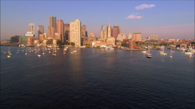 aerial view over bay towards waterfront area / boston, massachusetts - waterfront stock videos and b-roll footage
