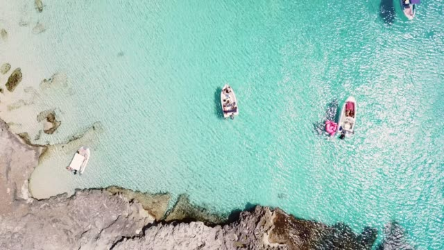aerial view over boats in the blue mediterranean sea - balearic islands stock videos and b-roll footage
