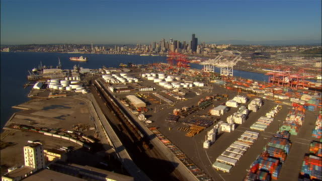 stockvideo's en b-roll-footage met aerial view over boeing plant and port with downtown in background / seattle, washington - noordelijke grote oceaan