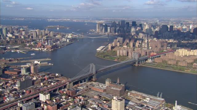 Aerial view over Brooklyn and Williamsburg Bridge towards Lower Manhattan with Manhattan and Brooklyn Bridge in background / New York City, New York