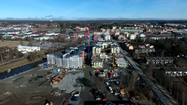 aerial view over building site - quadcopter stock videos & royalty-free footage