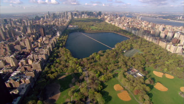 aerial view over central park towards downtown / new york city, new york - central park manhattan stock videos and b-roll footage