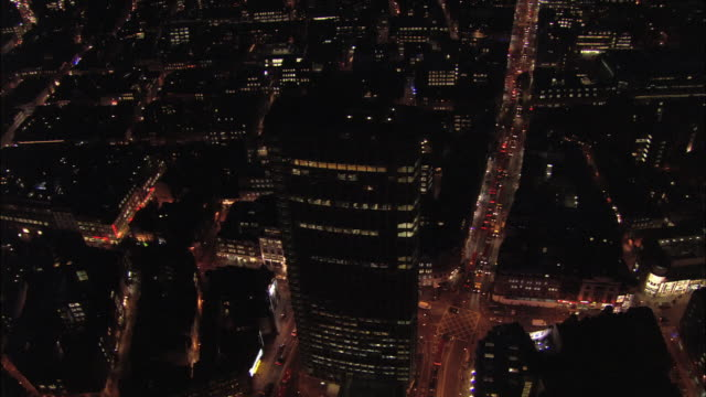 aerial view over centre point to reveal oxford street at night / london, england - tottenham court road stock videos & royalty-free footage