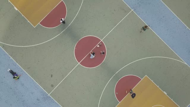 stockvideo's en b-roll-footage met aerial view over colorful basketball court - bal
