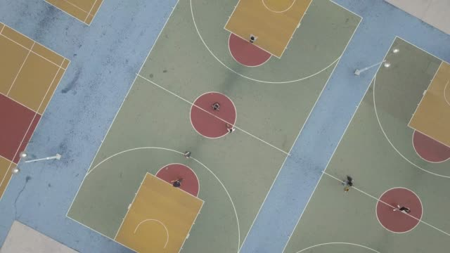 aerial view over colorful basketball court - hong kong stock-videos und b-roll-filmmaterial