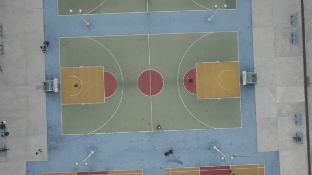 vídeos de stock, filmes e b-roll de aerial view over colorful basketball court - court