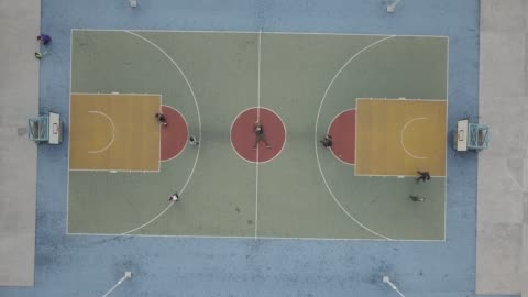 aerial view over colorful basketball court - sports court stock videos & royalty-free footage