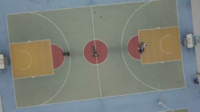 aerial view over colorful basketball court - sports round stock videos & royalty-free footage