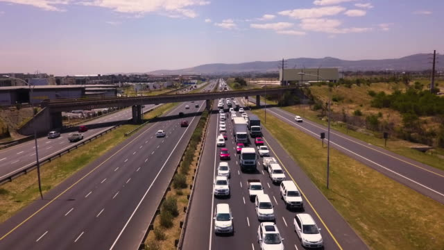 aerial view over congested highway - traffic jam stock videos and b-roll footage