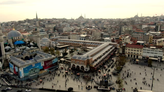 aerial view over eminonu square and the spice bazaar in istanbul, turkey, covered, 17th-century market known as the egyptian bazaar, with spice, food & textile shops-  istanbul, turkey - spice bazaar stock videos & royalty-free footage