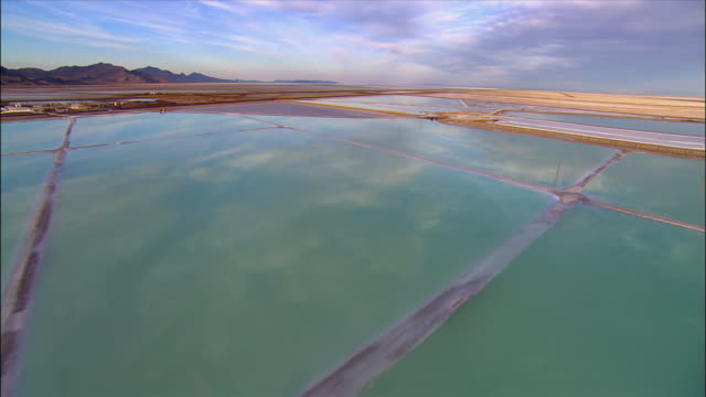 aerial view over evaporation pools at the bonneville salt flats / utah - bonneville salt flats stock videos and b-roll footage