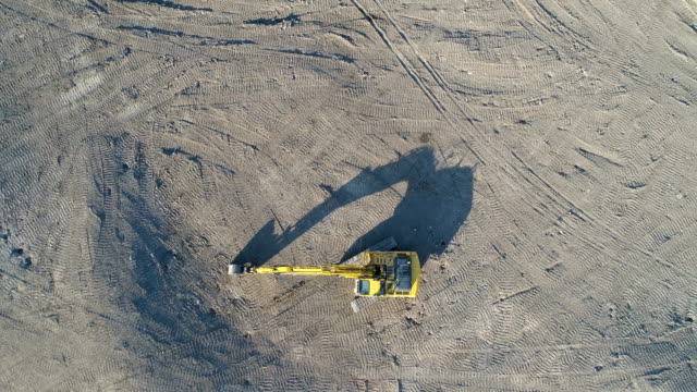 aerial view over excavator early in the morning - digging stock videos and b-roll footage