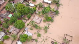Aerial view over flooded houses in village